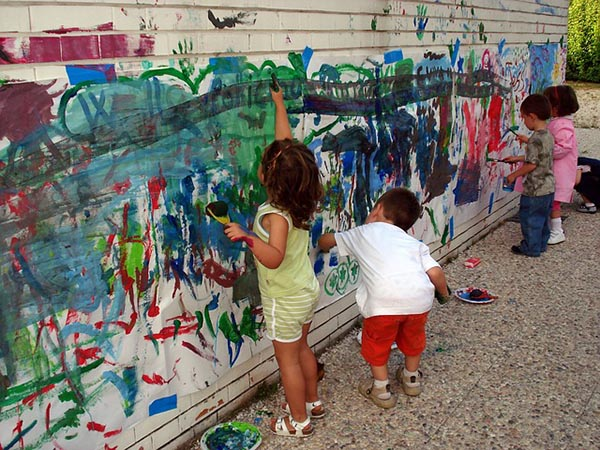 Children decorate the wall
