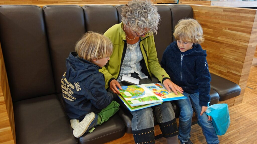 Grandma reads stories to her grandchildren