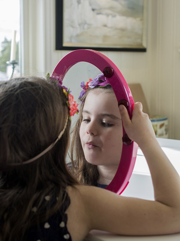 A girl looks in the mirror, photo credit Smengelsrud