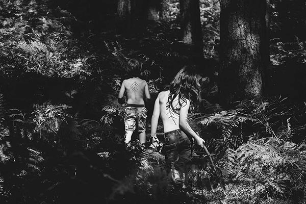 Kids are looking for a secret place in the woods