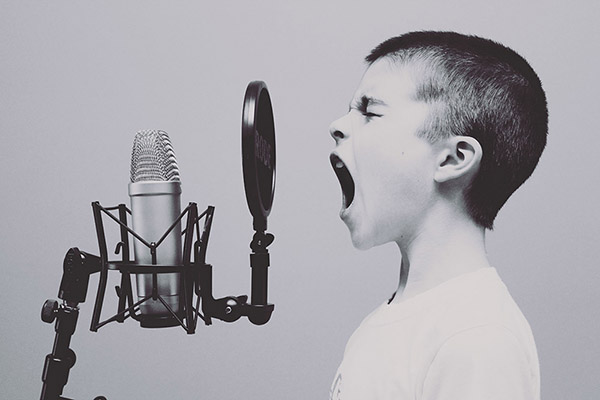 The boy sings, photo credit Jason Rosewell