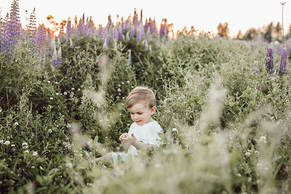 child surrounded by plants-liana-mikah