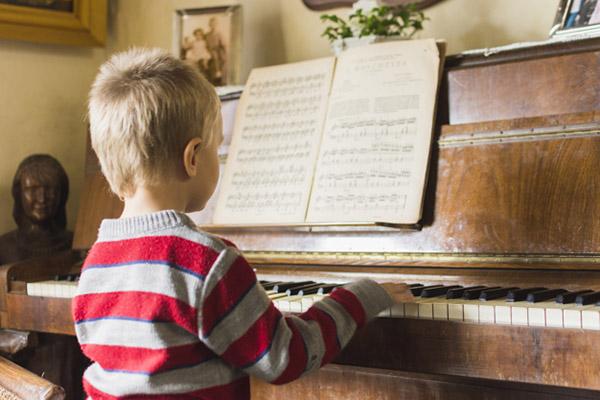 Boy playing piano at home