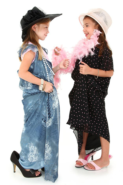 Two girls play an imaginative dress up game