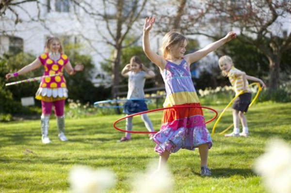Girls are playing Hoola Hoop game