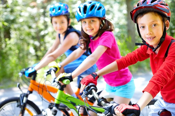 A group of children riding bicycles
