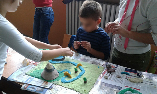 "Group work with clay, theme ""My village"""