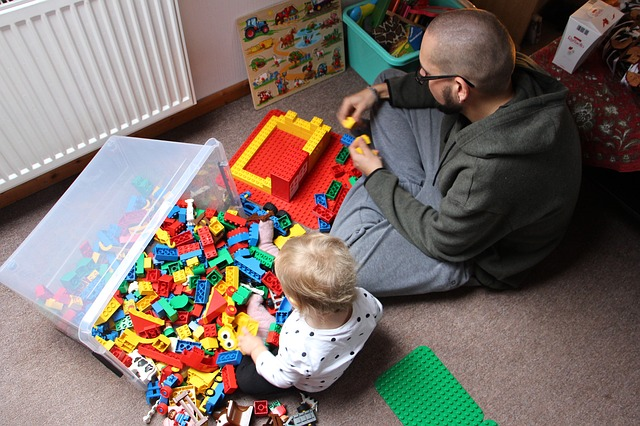 Father and son play with blocks