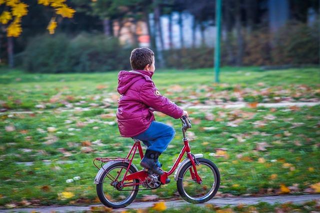 A kid rides a bike