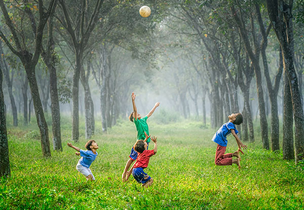 The kids are playing with ball,photo credit Robert Collins