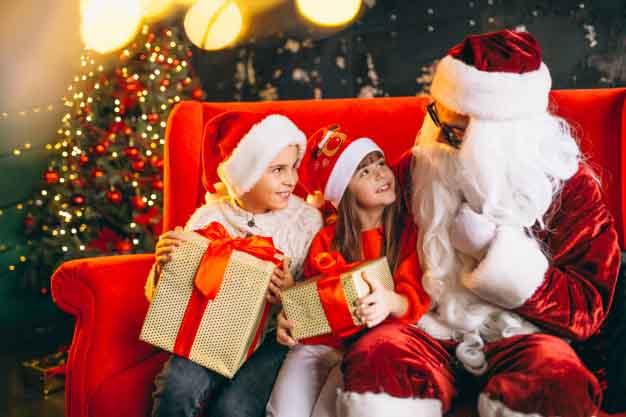 Group kids sitting with Santa presents Christmas, photo credit Sanivpetro