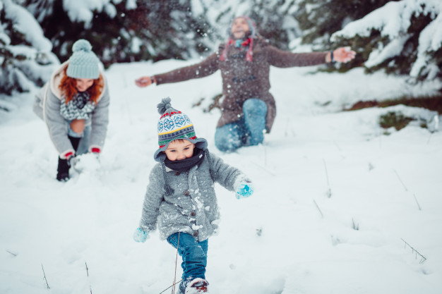 Small-child-running-along-snow