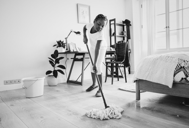 Young-teen-girl-sweeping-up-floor, photo credit Rawpixel