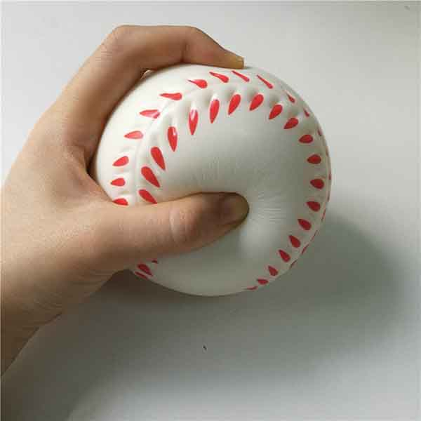 Boy squeezes the soft ball with his hand