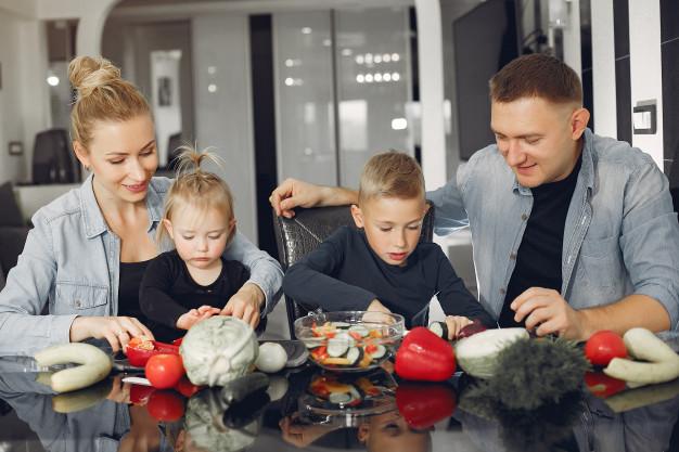 The family prepares dinner