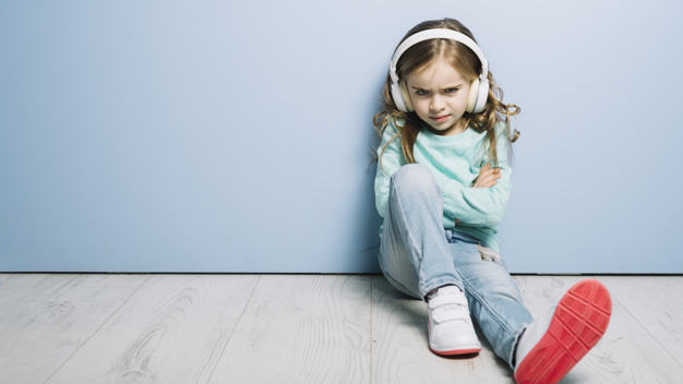 An angry girl listens to music